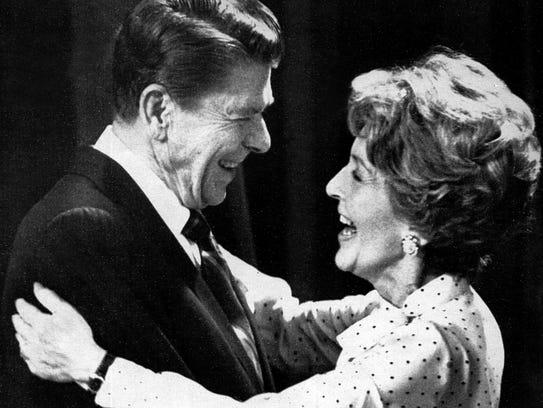 President Ronald Reagan gets a hug from Nancy Reagan