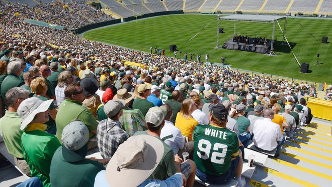 Green Bay Packers shareholders listen as president Mark Murphy addresses them from the stage inside Lambeau Field during the 2014 shareholders meeting.