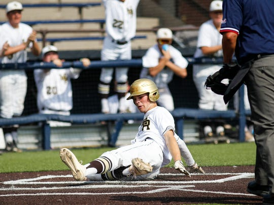 Drake Soblesky slides into home against Saline second
