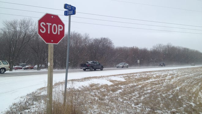 Monday's light snow covers the intersection of Iowa Highway 141 and I Court where a child was found sitting on Sunday, Dec. 29.