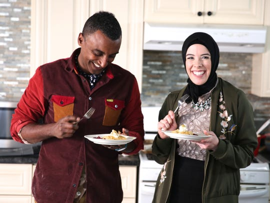 "Chef/host Marcus Samuelsson tests out some home cooking with Detroit pastry chef Lena Sareini on PBS' ""No Passport Required."""