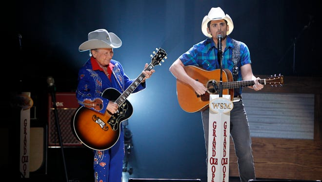 """Brad Paisley, right, and Little Jimmy Dickens perform """"Will the Circle be Unbroken?"""" at the Grand Ole Opry. They were good friends and fishing buddies for 15 years."""