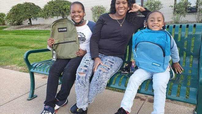 Jivonna Dent, a team member at Tyson Foods in Zeeland, with her children Jasmine and Skyler, who each received a new backpack filled with supplies from Tyson.