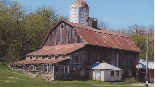 The Joe and Joanne Bechtold dairy barn, in an earlier day, stands proudly in rural St. Joseph.