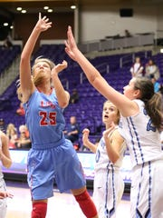 USJ's Anna Jones (25) puts up a shot against Northpoint