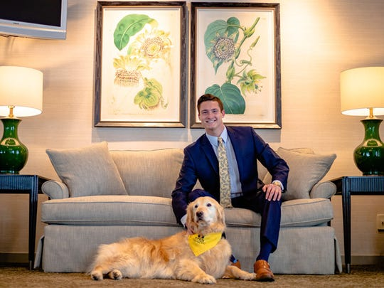 Pictured with Riley, a golden retriever, is Christian Kreamer, a current student at Pittsburgh Institute of Mortuary Science who will graduate in September 2019.
