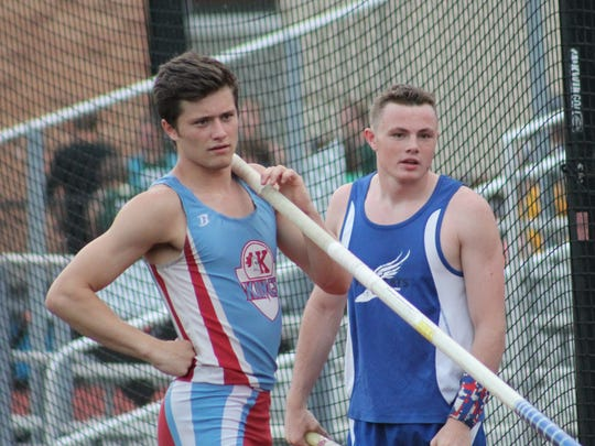 Kings vaulter Grant Coleman and Williamsburg junior Wyatt Lefker wait their turn at the pole vault at the Anderson Invitational April 20.