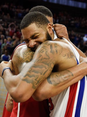 Pistons' Marcus Morris is congratulated by his brother Markieff Morris after his winning tip-in at the buzzer. Morris had a game high 25 points and 11 rebounds. The Pistons defeated the Washington Wizards, 113-112, Saturday, Jan. 21, 2017, at The Palace of Auburn Hills.