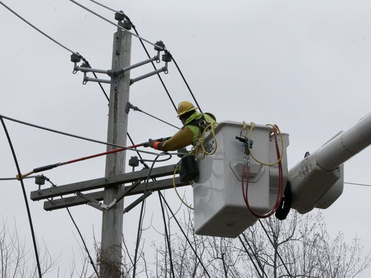 An Orange and Rockland crew repairs power lines on