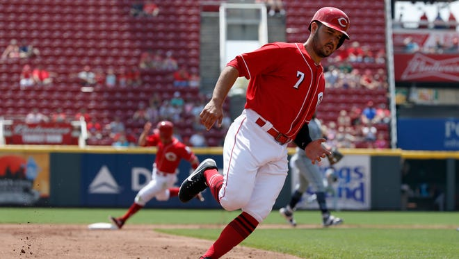 Cincinnati Reds third baseman Eugenio Suarez (7) and right fielder Patrick Kivlehan (3) round the bases to score on a Tucker Barnhart double in the second inning of the game between the Cincinnati Reds and the San Diego Padres at Great American Ball Park on Thursday.