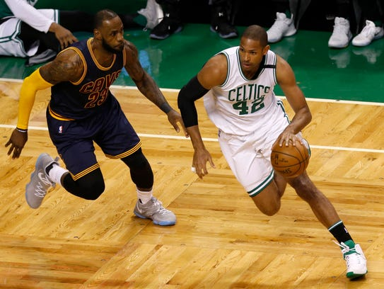 Celtics forward Al Horford, right, is defended by the