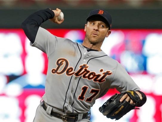 The Tigers' Andrew Romine pitches against the Twins