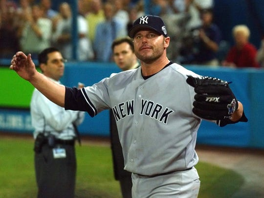 Yankees pitcher Roger Clemens reacts to the last out in the seventh inning against the Florida Marlins during Game 4 of the 2003 World Series at Pro Player Stadium in Miami.