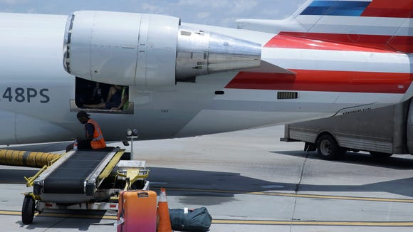 American Airlines grounds crew members sit and wait