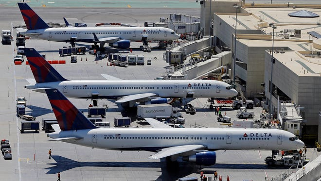 In this file photo from Sept. 4, 2013 photo, Delta jets are seen at Los Angeles International Airport.