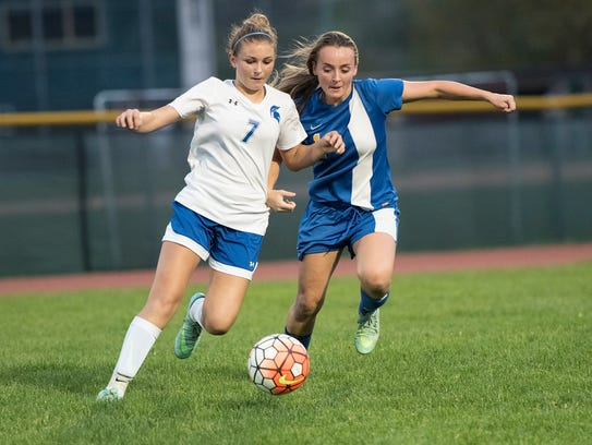McConnellsburg's Emma Ott (7) and Madison Yarnell (1)
