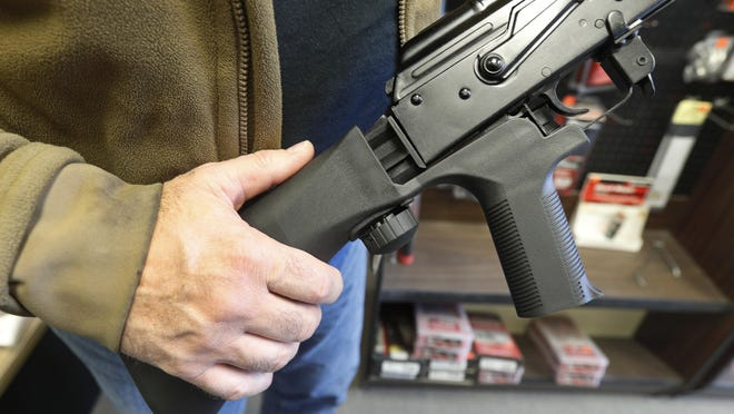 A bump stock device is installed on a AK-47 semi-automatic rifle, making it similar to a fully automatic rifle. An appeals court said Thursday a federal judge in Michigan should have blocked a Trump administration ban on bump stocks, a device that allows semiautomatic firearms to fire rapidly.