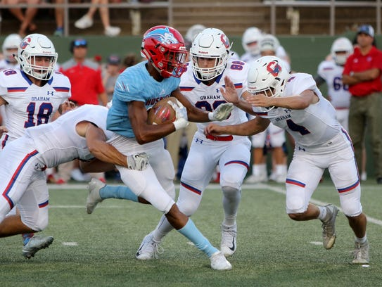 Hirschi's Javen Banks is wrapped up by Graham's Joel