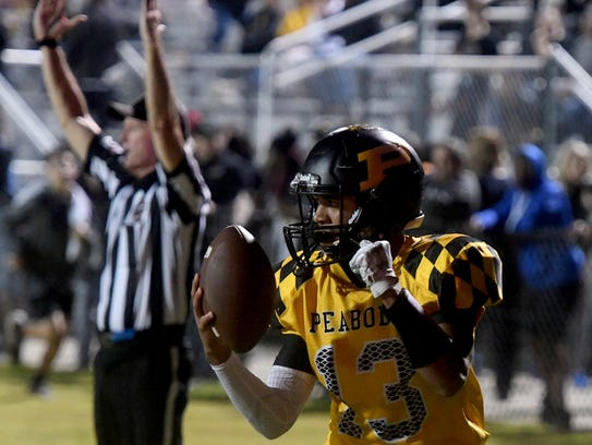 Peabody's Noah Holbrook celebrates his touchdown during