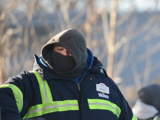 Attendant braves the cold at a gas station in Hackensack