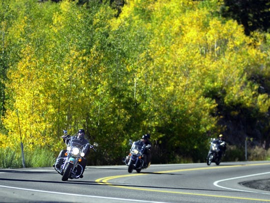 Motorcyclists cruise past fall colors on Mount Rose