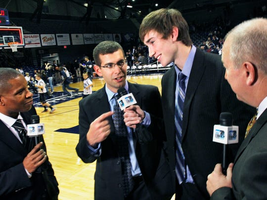 Butler University Head Basketball Coach Brad Stevens, second from left, points to Butler player-turned pro Gordon Hayward, now with the Utah Jazz during an interview with play-by-play announcer Anthony Calhoun, left, and color analyst Ralph Reiff, right, following Butler's 57-42 win over Savannah State in a Hoosier Invitational game at Hinkle Fieldhouse in Indianapolis on Monday, November 21, 2011. Hayward, who is awaiting the end of the NBA lockout, worked the game as a guest analyst for WNDY-23's televised broadcast of the game. Charlie Nye / The Star.