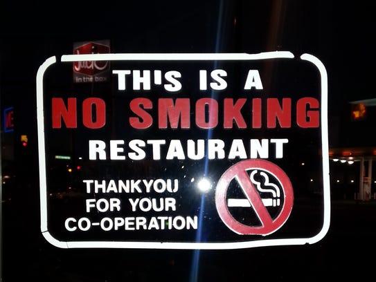 The sign on the front door of the KFC in Mesquite notifies