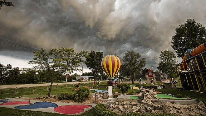 Visitors of the Fondy Sports Complex in Fond du Lac seem unfazed to the approaching storm clouds in Fond du Lac. While the clouds looked intimidating, no severe weather was reported. Tuesday, July 18, 2017.