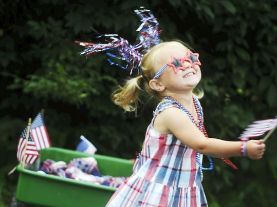 Grace Brown, 2, of Springfield Township waves her flags before the children's parade, part of the Fourth of July Blast in Jacobus last year. Don't miss the family-friendly event this year with food, activities and fireworks at dusk.