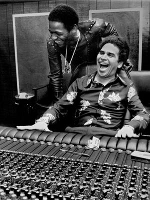 Al Green (standing) and Willie Mitchell at the mixing board at Royal Studios.
