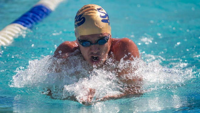 Joshua Harriott of Southwest Florida Christian Academy races in the 200 Yard IM on Wednesday in Fort Myers. Harriott won the race with a time of 2:08.35.