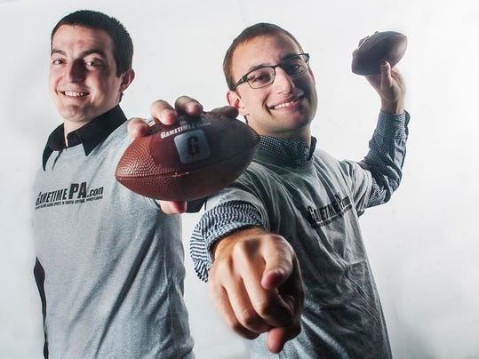 Evening Sun sports reporters Brandon Stoneburg (left) and Zach Miller pose for a photo April 14.
