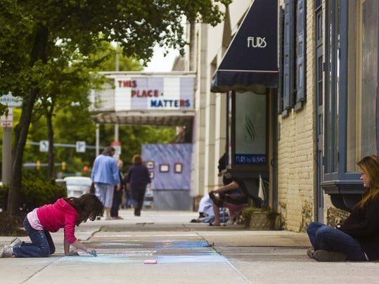 Jamie Morris, right, of Hanover, watches her 6-year-old daughter, Alexis Lucas, as she works on chalk art during Chalk it Up Hanover in 2013.