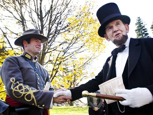 """Jim Getty, right, portraying President Abraham Lincoln, shakes hands with Anthony Catella, portraying a Confederate Captain from Louisiana, prior to giving """"The Gettysburg Address"""" on the 147th Anniversary of President Lincoln's speech at Gettysburg. Getty died Sept. 26. Funeral services are set to take place Friday in Gettysburg."""