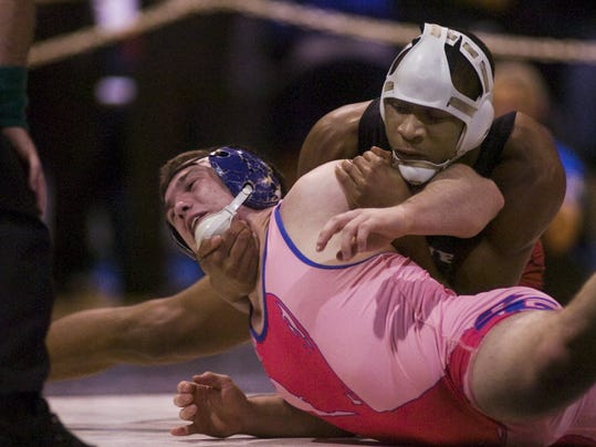 Dover's Shaheed Mitchell works on subduing Spring Grove's Andy Melhorn in the 182-pound semifinal at the PIAA sectional wrestling tournament at South Western High School. Both are seniors this season. (GAMETIMEPA.COM - FILE)