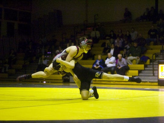 Delone's Antonio Ugarte wrestles with Bermudian's Bayley Oberlander in last years match. The Eagles and Squires meet on Thursday.. Shane Dunlap - GameTimePA.com   Shane Dunlap