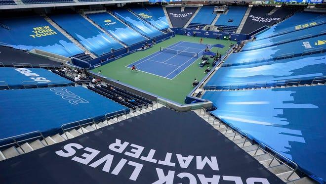Coco Gauff and Anastasija Sevastova play in front of an empty stadium at the US Open.