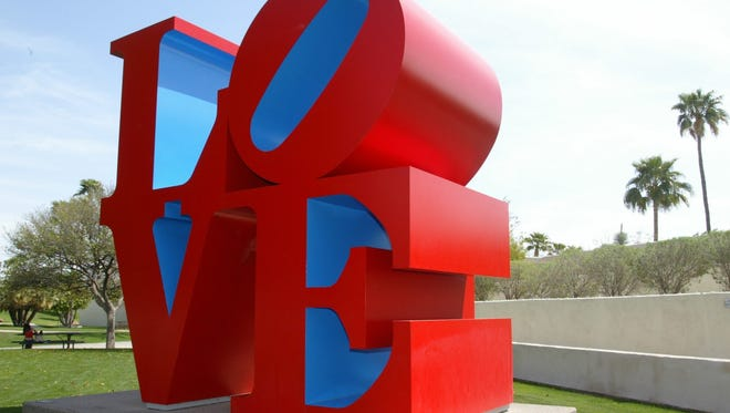 """Robert Indiana's """"LOVE"""" sculpture, which sits on the pedestrian overpass above Drinkwater Boulevard in Scottsdale's Civic Center Mall, will move to a nearby location on Friday. The sculpture, which came to Scottsdale in 2002, has been closed to public access since late July due to ongoing inspection work concerning concrete deterioration of the bridge."""