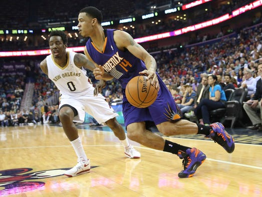 Suns guard Gerald Green (14) drives toward the basket in front of New Orleans Pelicans forward Al-Farouq Aminu (0) in the first quarter at the Smoothie King Center.