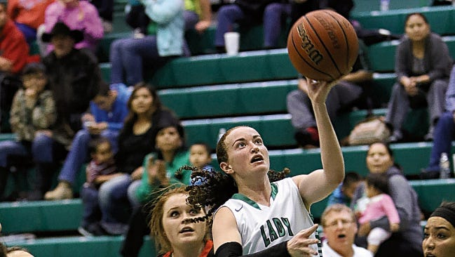 Farmington's Shayla Carlowe attempts a layup against Aztec during a game on Jan. 23 at Scorpion Gym in Farmington
