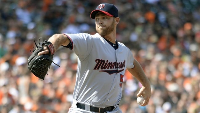 Aug 23, 2015; Baltimore, MD, USA; Minnesota Twins relief pitcher Neal Cotts (55) pitches during the fifth inning against the Baltimore Orioles at Oriole Park at Camden Yards.