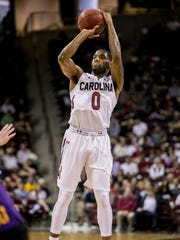 Nov 27, 2015; Columbia, SC, USA; South Carolina Gamecocks guard Sindarius Thornwell (0) attempts a three pointer against the Lipscomb Bisons in the first half at Colonial Life Arena. Mandatory Credit: Jeff Blake-USA TODAY Sports