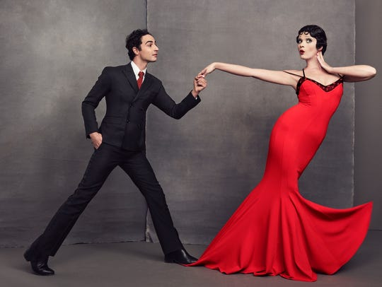 Crystal Renn models the $550 gown with designer Zac