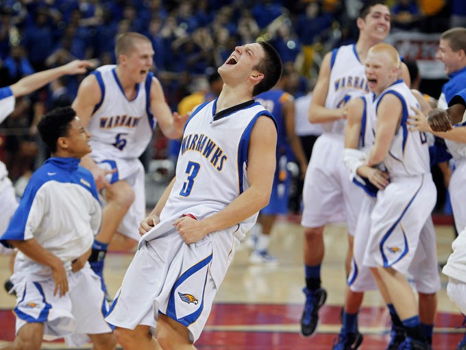 Germantown's Zak Showalter (center) celebrates with