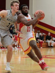 Javonta Lyons muscles his way to the basket for Purcell
