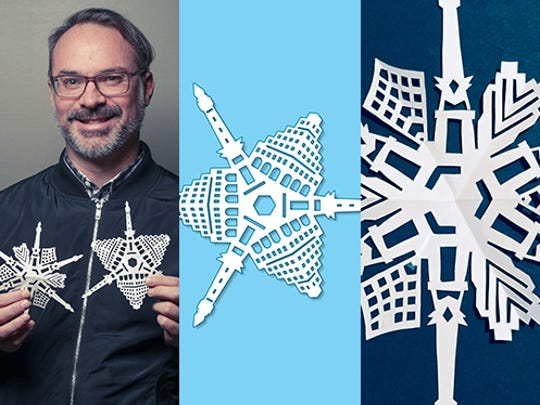 Craig McCormick, principal at Blackline Studio, holds the Soldiers & Sailors Monument-inspired snowflakes he created.