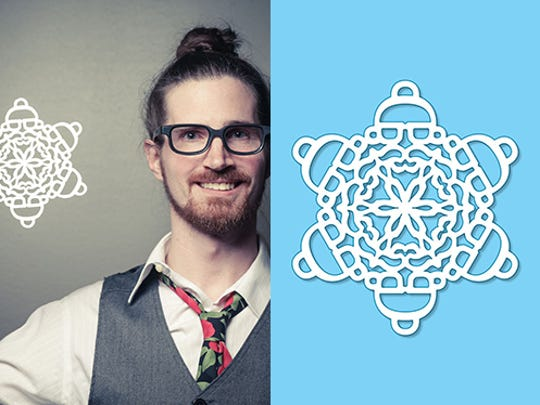 Artist George Meluch holds the hipster Santa snowflake he created.