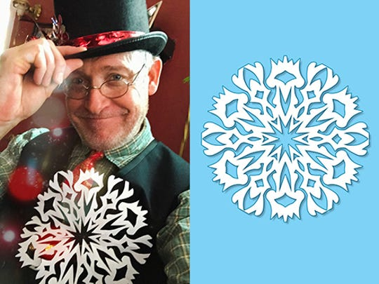 Artist James C. Kelly, of Mad Lab Studio holds the snowflake he created.
