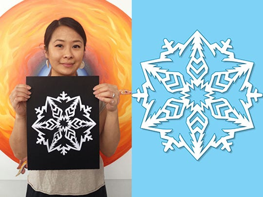 Artist MaryAnne Nguyen holds her snowflake.