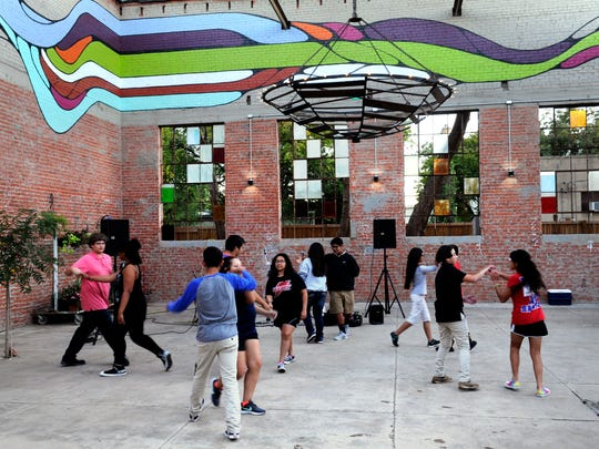 Teens dance at the SODA Courtyard Thursday Nov. 2, 2017. The building, which stands for South of Downtown Abilene, is where the former Boy's Club once was located.